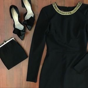 Little black dress with gold accents